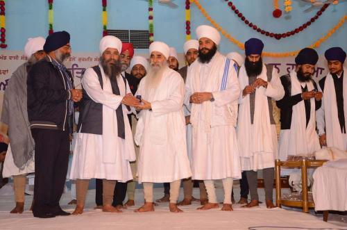Sant Baba Amir Singh ji Mukhi Jawaddi Taksal and Sant Baba Harbhajan Singh ji releasing Gutka Sahib of Nitem and Sukhmani Sahib